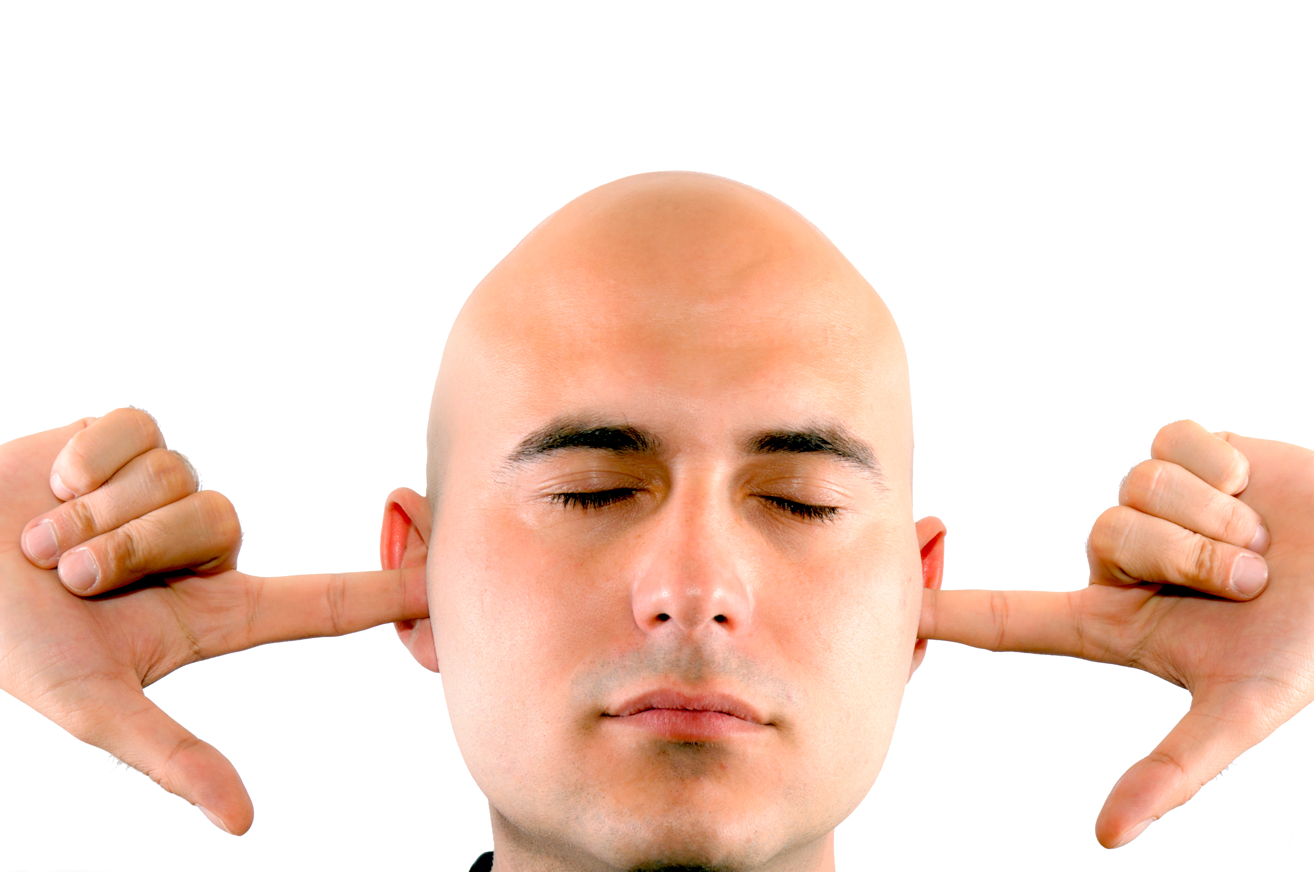 man with fingers in ears not listening